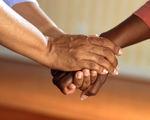 clasped-hands-showing-empathy